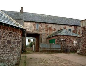 Old stone building with archway.