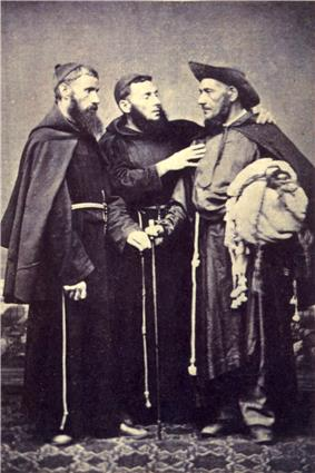 A photograph showing 3 standing men wearing religious habits