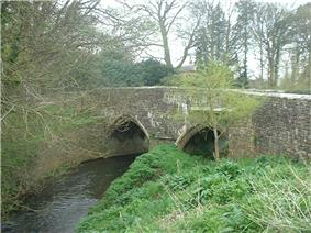 Stone two arch bridge over river