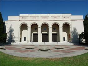 Exterior of auditorium with large white pillars