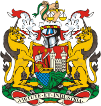 A coat of arms, with a shield showing a sailing ship and a castle with maned lions on either side, surmounted by the helmet from a suit of arms and two hands holding a snake and scales of justice. The motto at the bottom is