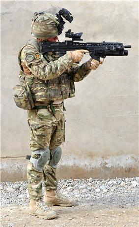 A British Army infantryman showing full combat dress and standard personal kit (front)