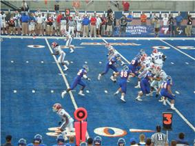 A play during a game between Boise State and Louisiana Tech on Bronco Stadium's blue-colored artificial turf