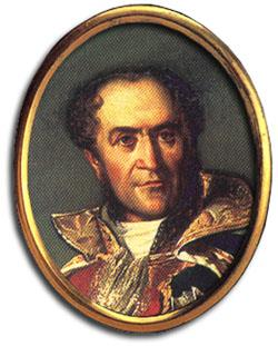 Portrait of a slightly balding man in blue uniform with gold collar
