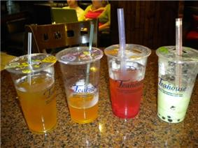 Four Bubble Tea drinks of different flavors.