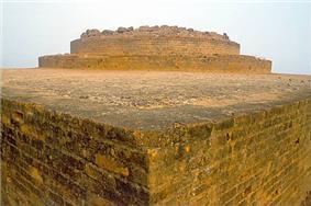 Corner of light-coloured, angular stone ruins