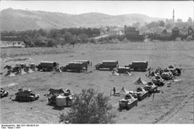 a black and white photograph of German armoured vehicles and tents in a square formation in open country