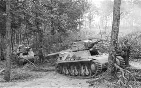 a black and white photograph of several tracked vehicles in a forest