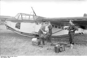 a black and white photograph of a wide-bodied military glider