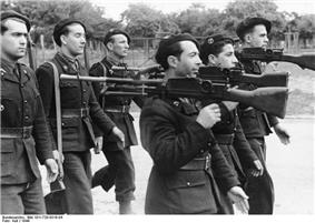 Black-and-white photo of men in uniform with guns