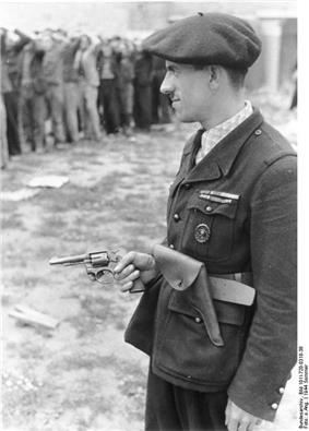Man in uniform, wearing a beret and holding a revolver