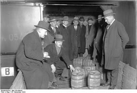men standing around looking at barrels
