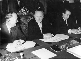 Walter Hallstein, Konrad Adenauer and Herbert Blankenhorn sitting at the conference table