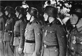 a black and white photograph of a line of Waffen-SS soldiers on parade