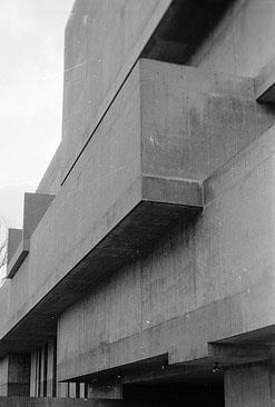 Imposing grey concrete blocks of 20th-century modernist architecture.