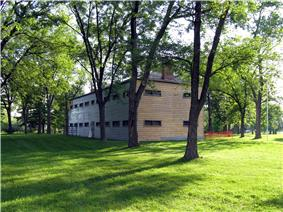 A view of Butler's Barracks among a grove of trees