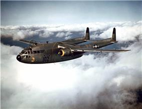 A stocky, unarmed military aircraft in flight