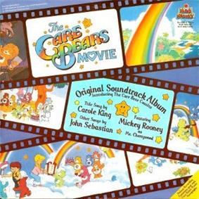 Filmstrips run horizontally upon a blue background, with various frames depicting scenes from the film. One frame has the title logo on it, while another lists the album name and three of the performers (in the franchise's specialised font).