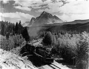 Image of a Canadian National Railways EMD GP9 locomotive climbing in the Yellowhead Pass