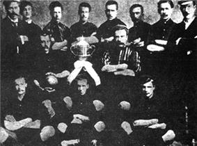 Old team photo, with players around a trophy