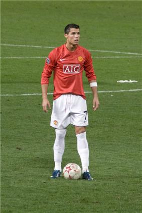 A footballer playing for Manchester United who is preparing to take a free kick
