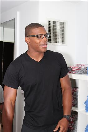 A picture of Cam Newton with glasses on.