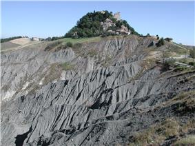 View of the Rock of Canossa with the ruins of the castle visible at the top