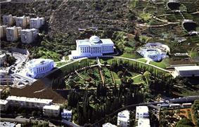 Large white buildings in a landscape garden.