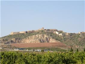 Large hill topped with castle walls