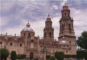 Large church with two main towers and two cuppolas.