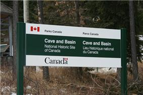 The descriptive sign at the entrance of the Cave and Basin National Historic Site in Banff, Alberta, Canada
