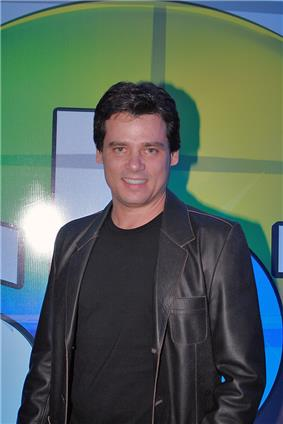 Smiling young man, dressed casually in black