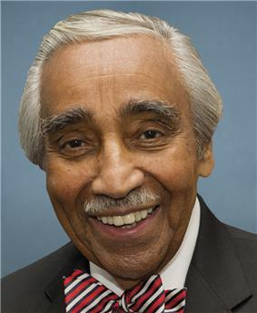 Official photograph of Charles Rangel dressed in suit and tie against a blue background