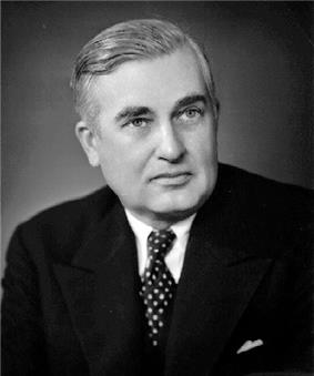 Middle-aged man with neatly combed hair, wearing a suit and tie.