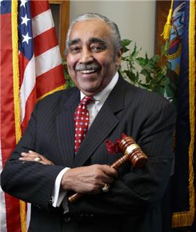 Official pose of Rangel holding a gavel, dressed in a suit and in front of an American flag