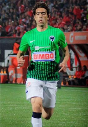 César Delgado, while playing for CF Monterrey, is seen running.
