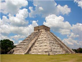 A large nine-storied stone pyramid with smoothed surfaces and stairs leading to the top from at least two sides. At the top of the pyramid there is a square structure with flat roof and entrances from both visible sides.