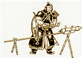 A man in black armor standing in front of a rocket, attached to a stick, with the stick being held up by two X-shaped wooden brackets.
