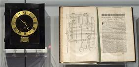 Spring driven pendulum clock, designed by Huygens, built by instrument maker Salomon Coster (1657) , and manuscript Horologium Oscillatorium