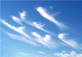 Hooked cirrus clouds showing the cirrus uncinus subform.