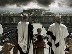 Men in white robes with the Colosseum in the background.
