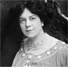 Head and shoulders shot of an Edwardian woman with dark hair, looking towards the camera