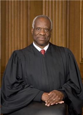 photograph of a man in judge robe