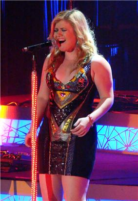 A woman singing a high note.