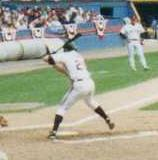 Jim Thome batting left-handed in a game in 1993; he is amidst his stride forward, and is about to swing.