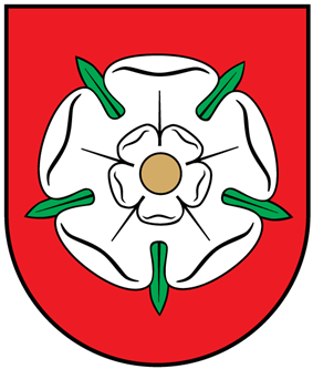 A coat of arms depicting a white flower in the middle that has a yellow stamen and green leaves all on a red background