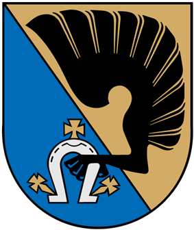 A coat of arms depicting a black wing attached to a black tallon holding a white horseshoe attached to three yellow spurs