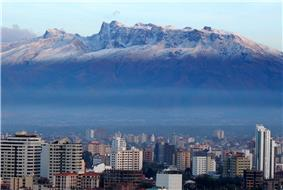 Downtown Cochabamba skyline with the Tunari mountain range in the background.
