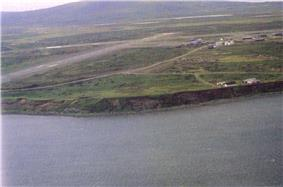 Cold Bay sometime in the late 20th century. Cold Bay Airport‍ '​s runways are visible.