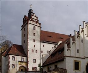 a whitewashed building with a red tiled roof, part of Colditz Castle